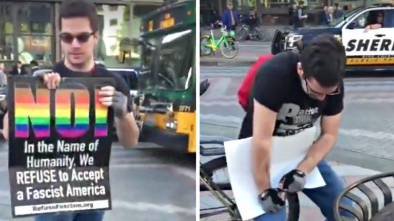 Epic fail d'un homophobe d'extrême droite contre une pancarte arc-en-ciel à Seattle