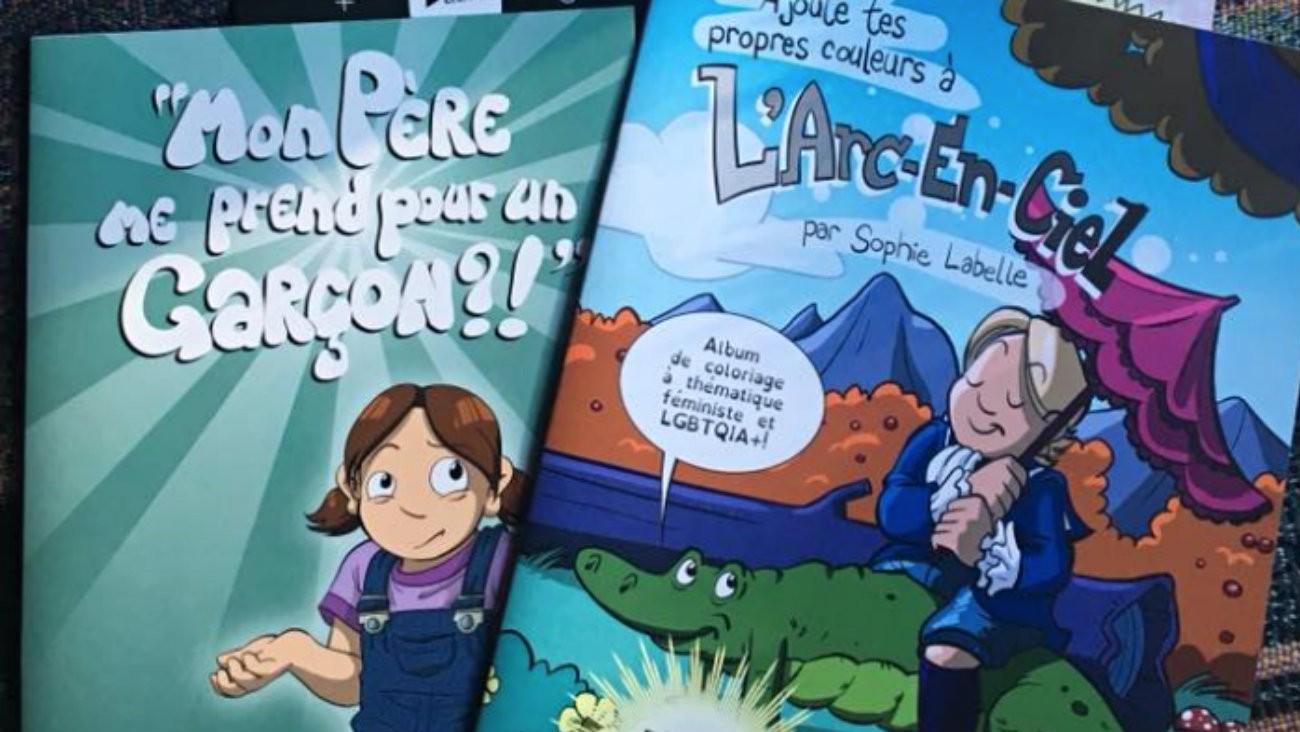 L'auteure de bande dessinée et militante ouvertement trans québecquoise Sophie Labelle offre ses livres aux écoles pour sensibiliser professeur.e.s et élèves aux questions de genre et à la transidentité